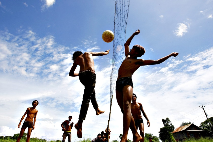 Cambodian villagers play volleyball at Sre Ampel village,  Kanda